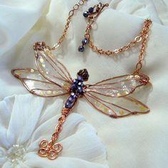 Dragonfly necklace, with resin wings and copper wire. Beautiful!