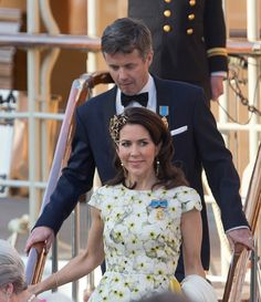 Crown Prince Frederik and Crown Princess Mary of Denmark leave the Danish Royal Yacht The Dannebrog to attend the Banquet at The Royal Palace in...