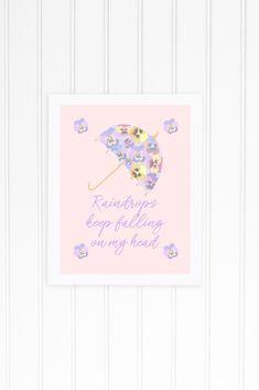 Adorable instantly printable nursery print \'Raindrops Keep Falling on My Head\'  The perfect addition to any girl\'s bedroom or nursery. #Printable #NurseryArt #NurseryPrintable #DigitalDownload #Raindrops #GirlsDecor #NurseryDecor