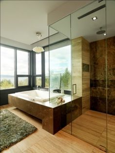 I love the combo of textures on the walls and floors. Is the floor tile porcelain and the wall in shower marble?