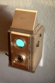 We love vintage cameras as displays but here they not only look great but they are also useful as nightlights. Old Cameras, Vintage Cameras, Chandelier, Nightlights, Reuse Recycle, Retro, Lamp Light, Decoration, Repurposed