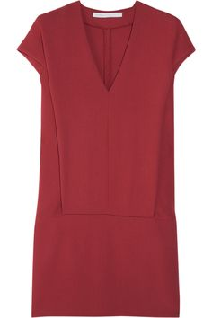 Victoria, Victoria Beckham's dark-red wool-crepe mini dress is a lesson in modern minimalism. We love the clean lines and relaxed fit. Team this elegant style with a simple gold cuff and flats.