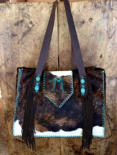 """A custom Buckaroo Diaper Tote with turquoise suede """"M"""" for Memphis and suede fringe and turquoise stones on the straps.  That's one lucky baby!  gowestdesigns.us"""