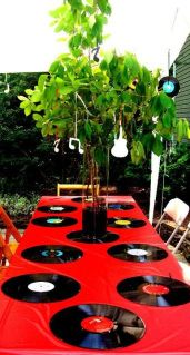 Both of my brothers are very into music. So, for their graduation party we had a music theme. Only made sense. :) We were also doing it on a budget. All of our decorations were either hand made, fr…
