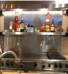 Stainless Steel backsplash  with stainless steel shelf above range  - perfect