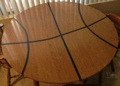 Basketball themed party table - could use orange tablecloth with black tape