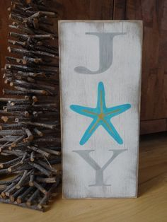 Joy hand painted wood sign. I made this fun coastal Christmas sign because of my love for the beach. It would add some tropical Christmas