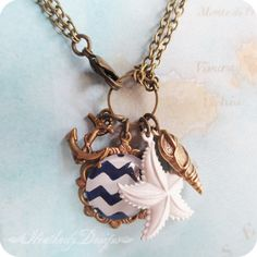 Seafarer: hand painted navy and white chevron cab and anchor starfish and seashell aged brass charm necklace