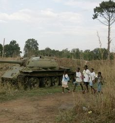 In post-war Angola, returnee children pass a wrecked panzer on their way to the reconstructed school. Warsaw Pact, Brothers In Arms, Defence Force, People Of The World, Republic Of The Congo, Tanzania, Tanks, South Africa, Rust