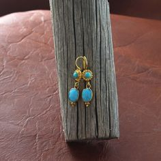 18k Gold and Sleeping Beauty Turquoise Earrings Faceted 2 Stone from New World Gems