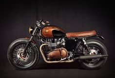 Creative Photo of Triumph Bonneville Custom. Triumph Bonneville Custom This Custom Triumph Bonneville Got A Mean Makeover. Styled when the Bonnies of the and the 'new' Bonneville wa. Triumph Cafe Racer, Triumph Bonneville Custom, Triumph Bikes, Cafe Racer Motorcycle, Motorcycle Style, Triumph Motorcycles, Cafe Racers, Triumph T100, Bonneville Motorcycle