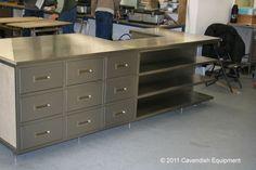 Stainless steel kitchen cabinets, door in frame, recessed handles.