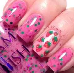 Strawbrie Fields Forever by Glam Polish. Strawbrie Fields Forever - Small green dots with holo pink hex and diamonds in a berry base - Created by @Hannah Barber, part of the Insta-glam Collection.