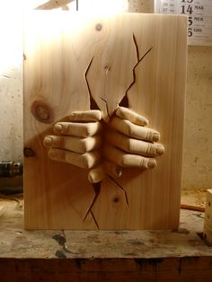 Wooden sculpture made by S-Carving (hands out of the wall)
