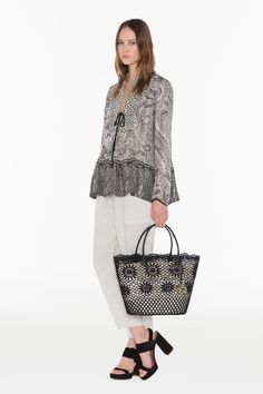 TWIN-SET Simona Barbieri, 2016 Summer collection: cashmere print twill blouse, lurex linen slouchy drainpipe trousers, rigid macramé shopping bag with metal heart pendant and suede sandal with macro buckle.
