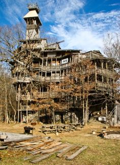 The worlds largest treehouse, located in Crossville Tennesse stands 97 feet tall and is based on 6 trees. This structure took builder Horace Burgess 11 years to build. Burgess, who now lives in the 10-story wooden house, says he began building it in 1993 after he received the go-ahead from God.