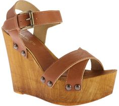 Women's Charles by Charles David Munich Wedge Sandal - Camel Leather with FREE Shipping & Exchanges. The Munich Wedge Sandal is a darling vintage inspired sandal with its wooden platform and wedge