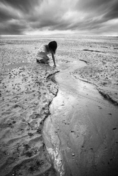 Christophe Lecoq Searching For Seashells On The Beach So Peaceful Photo
