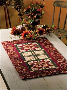 Autumn Song Table Runner Quilt Pattern Download from e-PatternsCentral.com -- Two Star Crossed blocks and an Uneven Nine-Patch Cross form the basis for this autumnal pieced table runner in rich autumn hues.