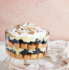 Trust us: You'll be using these easy trifle recipes throughout the holiday season. It's one of the creamiest Christmas desserts there is. Find a new favorite trifle idea right here, from no bake recipes to holiday ones. Best Trifle Recipe, Trifle Bowl Recipes, Trifle Desserts, Easy Desserts, Delicious Desserts, Dessert Recipes, Martini Recipes, Snickers Cheesecake, Cheesecake Trifle