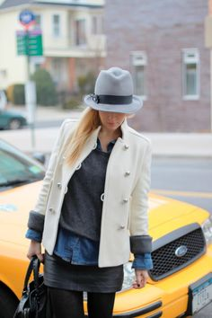 grey sweater, chambray button down, black leather skirt, grey tights, black booties, grey fedora, white coat