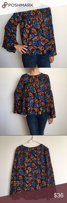 """Clarissa Bell sleeve top"" Adorable Bohemian floral top. Long sleeve, bell sleeve. Navy blue. Trending this season. Available sizes small, medium and large. No low ball offers. Reasonable offers are welcome! Tops Blouses"