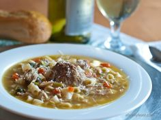 A delicious and hearty Italian chicken soup with meatballs, escarole, vegetables, and pasta. Also called Italian Wedding Soup.