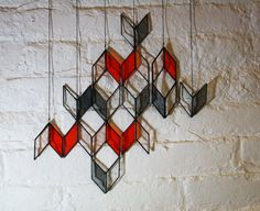 """""""Diamond Drops""""   Basically  Tumbling Blocks quilt pattern with one piece, the chunkier diamond, left open. Looks good!"""