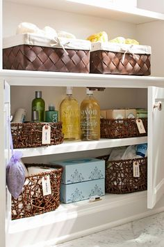In the bathroom, storage solutions are often part of the display. Labeled wicker baskets organize extra bath supplies in a low cabinet. #storage #basketstorageideas #bathroom #bathroomorganization #bhg Bathroom Cabinet Organization, Basket Organization, Bathroom Storage, Bathroom Cabinets, Storage Baskets, Organization Hacks, Bathroom Closet, Organizing, Toilet Storage