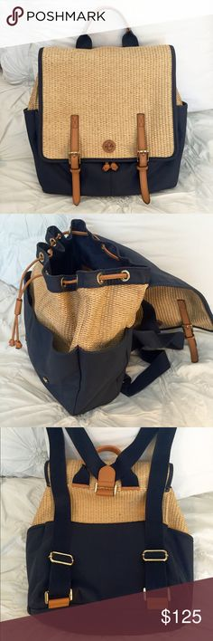 Tory Burch Navy Lydia Backpack Tory Burch navy canvas and straw Lydia backpack with brown leather trim, gold-tone hardware, woven lining, interior pockets, buckle accents at flap and magnetic snap closures at front. Two interior open pockets and one zip pocket. Four outer pockets. Adjustable straps. Used a handful of times. Small signs of wear on bottom. Tory Burch Bags Backpacks