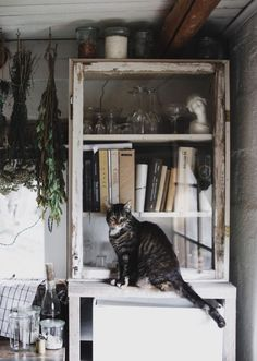 my scandinavian home: A Magical Norwegian Cottage With a Wabi Sabi Vibe Norwegian House, House Of The Rising Sun, Sheepskin Throw, Magical Home, Porcelain Sink, Scandinavian Countries, Vintage Mirrors, String Lights Outdoor, World Of Interiors