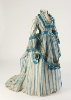 Blue striped cotton gauze day dress from 1874.