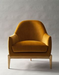 — Fully upholstered armchair with tight back — All-foam seat cushion — Hand-cast base in solid bronze — Solid hardwood frame with European webbing and multidensity foam