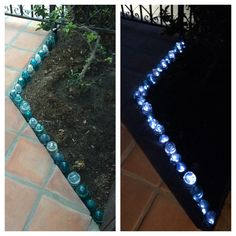 Glass Insulator Garden Border lit underneath with a string of solar powered LEDs.