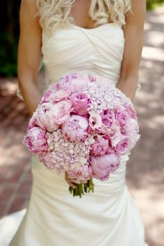 Hydrangeas, garden roses, peonies and lisianthus in every shade of pink made us blush at this @Mandy Bryant Dewey Seasons Resort The Biltmore Santa Barbara wedding.