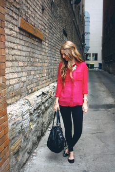 Wear a pink shirt over a white tank top with a statement necklace and black pants. // Just Zipped