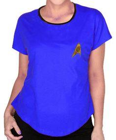 Camiseta chica Uniforme azul. Star Trek Estupenda camiseta para chica en color azul de la exitosa saga de Star Trek, 100% oficial y licenciada con la imagen del logo de la federación.