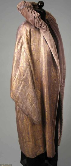 LILAC & LAME OPERA COAT, EARLY 1920s Lilac silk w/ all-over large reptile pattern, pale lilac silk velvet lining & ruched collar.  Sideway