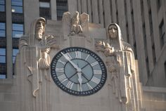 Sculptural work by Alvin Meyer, Holabird & Root's sculpture department, represents the trading activities within. Hooded figures on each side of the 13' diameter clock facing LaSalle Street: Egyptian holding grain, Native American holding corn.