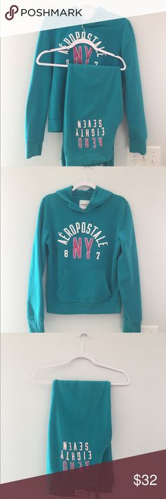 AERO Turquoise/Pink SET  Large TOP Medium PANTS Aeropostale Sweatshirt/Sweatpants set. Turquoise with pink glitter number detailing on both top and bottom. PRE-LOVED. NO HOLES OR TEARS OR LOSS OF GLITTER. any questions please ask before purchase ✌ Thank you for stopping by  LARGE TOP/MEDIUM PANTS. Aeropostale Tops Sweatshirts & Hoodies
