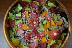 mixed greens with roasted beets, blood oranges, pomengranate seeds, and candied almonds