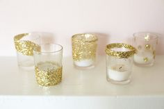 As with any holiday, it's kind of a must for us to add a bit of sparkle wherever we can. That's why we're sharing this easy peasy DIY with you. We made these glitter votives to decorate ourholiday mantelin amatter of minutes and they're such a fun way to brighten up your holiday (or wedding) …