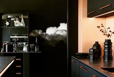 B L A C K C L O U D - Gradient Cloud Wallpaper. A collaboration between uber talented Photographer Jody D'Arcy & Creative Director Ann-Louise Lollo Jansson Scandianvian Wallpaper & Decor.  Kitchen trends including matte black cabinets, luxury bench tops and appliances and now moody skies to complete them! You must check this very modern kitchen out amongst many other kitchen trends on display at @thekitchenstudioiq  Cloud Series wallpaper available now from @scandinavian_wallpaper_decor Cloud Wallpaper, Wallpaper Decor, Ann Louise, Scandinavian Wallpaper, Black Cabinets, Uber, Then And Now, Creative Director, Matte Black
