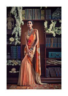 a floral creamsicle sari by Tarun Tahiliani.  Photographed by: Ashish Shah