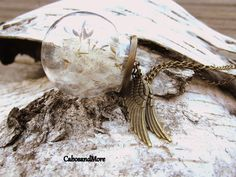 Flor de collar con real secado Pustenblumen.  El colgante está hecho de vidrio y con dientes de León están llenos.  El colgante está decorado con