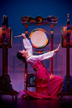 Traditional Korean Performance - The 'buk' (북) is a shallow barrel-shaped drum with a wooden body and played with bukchae (북채), or drumsticks. The drum was used in both folk and court music, each having their own style of playing.
