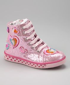 Sparkle and shine in these trendy hi-top sneakers. Covered in a glamorous glitter and sprinkled with shimmering hearts, this playtime perfect pair features a side-zip closure for an effortless fit.Side-zip closureCanvas upperTextile liningLeather footbed