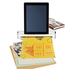 I discovered this handy new gadget that lets you scan photos, receipts, even your kids' artwork right to your iPad. Genius!