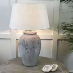 This rustic stone effect antique grey table lamp base is available as base only, or paired with an egg white textile shade. Base dimensions: x Shade dimensions: x x Rustic Table Lamps, Grey Table Lamps, Table Lamp Base, Lamp Bases, Earthy Home, Stone Lamp, Lamp Makeover, Rustic Stone, Jar Lamp
