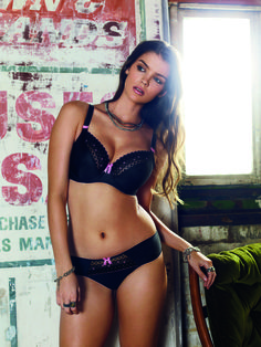 Feel enchanted in a rick black base enhanced by hot pink embroidery and polka dots. The Freya Enchanted, Black features sheer mesh inserts and cute bows scattered across the lingerie.